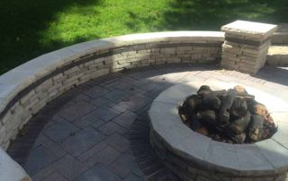 Unilock Rivercrest Seatwall with Columns and Fire Pit